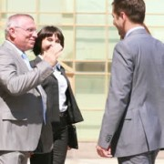 stock-footage-energetic-business-people-shaking-hands-and-having-a-cheerful-conversation